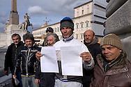 Roma, 4 Febbraio  2015<br /> Un gruppo di operai licenziati della  fabbrica di automobili Fca di Pomigliano d&rsquo;Arco, &egrave; andato  al Quirinale per consegnare una lettera al Presidente della Repubblica Mattarella, per denunciare la violazione dei  diritti dei lavoratori con il Jobs act.<br /> Rome, February 4, 2015<br /> A group of workers laid off in the car factory Fca Pomigliano d'Arco, went to the Quirinale Palace to deliver a letter to the President of the Republic Mattarella, to denounce the violation of workers' rights with the Jobs Act.