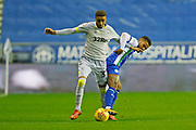 Derby County defender Jayden Bogle (37) and Wigan Athletic midfielder Reece James (12) contest a loose ball  during the EFL Sky Bet Championship match between Wigan Athletic and Derby County at the DW Stadium, Wigan, England on 8 December 2018.