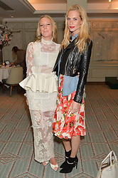 Left to right, ALICE NAYLOR-LEYLAND and POPPY DELEVINGNE at the launch of Mrs Alice in Her Palace - a fashion retail website, held at Fortnum & Mason, Piccadilly, London on 27th March 2014.