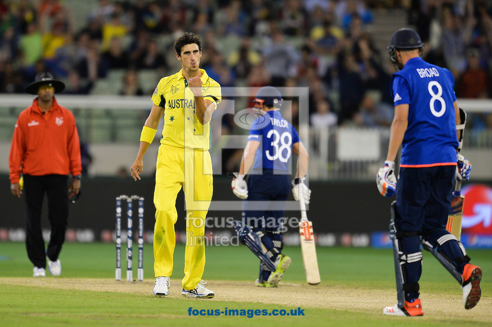 Mitchell Starc of Australia celebrates the wicket of Chris Broad during the 2015 ICC Cricket World Cup match at Melbourne Cricket Ground, Melbourne<br /> Picture by Frank Khamees/Focus Images Ltd +61 431 119 134<br /> 14/02/2015