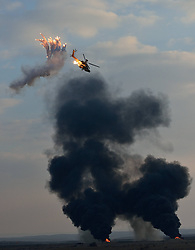 A Boeing AH-64 Apache longbow attack helicopter of Israeli Air Force (IAF) launches anti-missile flares during an air show at a graduation ceremony of Israeli military pilots at IAF s Hatzerim base near Beersheva, south Israel, December 27, 2012. Photo by Imago / i-Images...UK ONLY