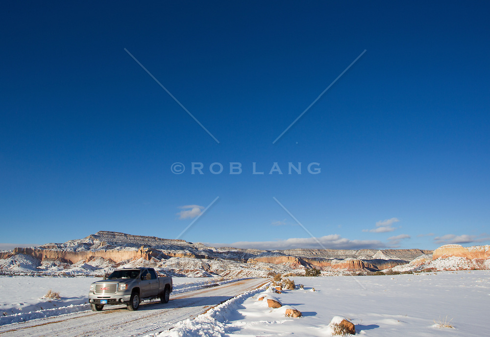 driving a truck on a snow covered road in Abiquiu, New Mexico