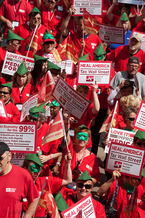 """Members of National Nurses United hold a rally in Chicago's Daley Plaza, on May 18th, 2012 on the 5th straight day of protests against the NATO summit that will be held May 20-21.  The Nurses , joined by members of Occupy Wall Street from all across the country, demanded a """"Robin Hood"""" tax on banks' financial transactions to help cover the cost of health care."""