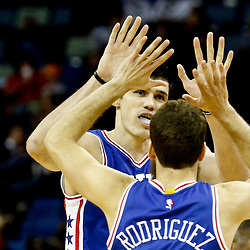 Dec 8, 2016; New Orleans, LA, USA; Philadelphia 76ers forward Ersan Ilyasova (7) celebrates with guard Sergio Rodriguez (14) during the second half of a game against the New Orleans Pelicans at the Smoothie King Center.  The 76ers defeated the Pelicans 99-88. Mandatory Credit: Derick E. Hingle-USA TODAY Sports