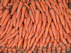 Carrots on vegetable stall in market, Mysore.