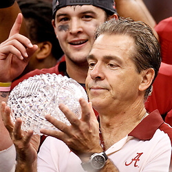 Jan 9, 2012; New Orleans, LA, USA; Alabama Crimson Tide head coach Nick Saban celebrates with The Coaches Trophy crystal ball after the 2012 BCS National Championship game win over the LSU Tigers at the Mercedes-Benz Superdome.  Mandatory Credit: Derick E. Hingle-US PRESSWIRE