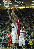 January 04 2010: Ohio State Buckeyes forward Jared Sullinger (0) puts up a shot over Iowa Hawkeyes forward Jarryd Cole (50) during the second half of an NCAA college basketball game at Carver-Hawkeye Arena in Iowa City, Iowa on January 04, 2010. Ohio State defeated Iowa 73-68.