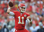 KANSAS CITY, MO - SEPTEMBER 15:  Quarterback Alex Smith of the Kansas City Chiefs throws a pass down field against the Dallas Cowboys during the first half on September 15, 2013 at Arrowhead Stadium in Kansas City, Missouri.  (Photo by Peter Aiken/Getty Images) *** Local Caption *** Alex Smith