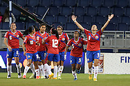 16 October 2014: Carolina Venegas (CRC) (9) celebrates her goal with teammates. The Mexico Women's National Team played the Costa Rica Women's National Team at Sporting Park in Kansas City, Kansas in a 2014 CONCACAF Women's Championship Group B game, which serves as a qualifying tournament for the 2015 FIFA Women's World Cup in Canada. Costa Rica won the game 1-0.