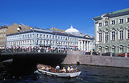 crowds on Nevsky Prospect and sightseers in<br /> a boat on the Griboyedov Canal<br /> St. Petersburg, Russia