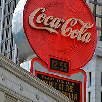 Coca-Cola Neon Sign in Atlanta, Georgia<br /> In 1932, a large red neon sign for a home-town company was raised in Margaret Mitchell Square in Atlanta. The iconic Coca-Cola trademark soon became a downtown landmark. The sign&rsquo;s design change over the years until it is removed in 1981. Fortunately, it made a return in 2003 with a retro-style look. Now the 33 foot diameter sign with over 10,000 bulbs is located on the Olympia building.