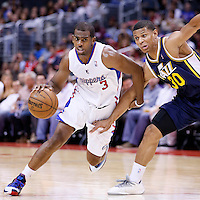 23 October 2013: Los Angeles Clippers point guard Chris Paul (3) drives past Utah Jazz point guard Scott Machado (30) during the Los Angeles Clippers 103-99 victory over the Utah Jazz at the Staples Center, Los Angeles, California, USA.