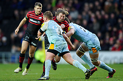 Saracens replacement (#18) Carlos Nieto is tackled by Northampton Hooker (#2) Dylan Hartley (Capt) during the second half of the match - Photo mandatory by-line: Rogan Thomson/JMP - Tel: Mobile: 07966 386802 30/12/2012 - SPORT - RUGBY - stadiummk - Milton Keynes. Saracens v Northampton Saints - Aviva Premiership.
