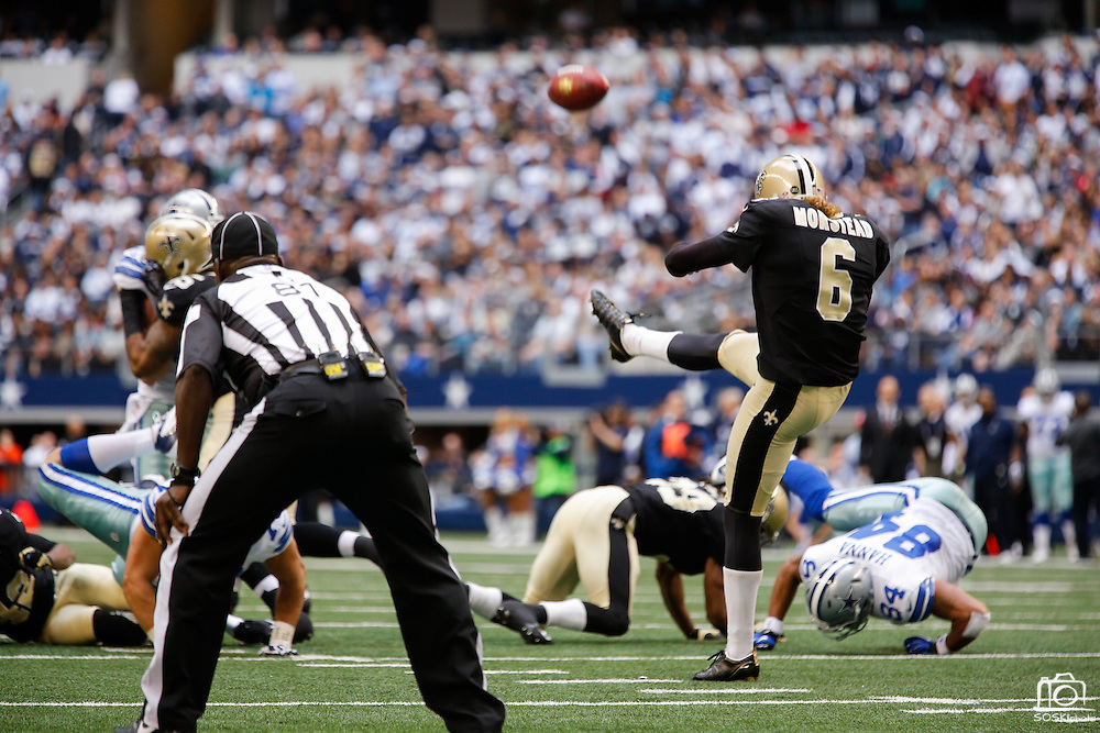 New Orleans Saints punter Thomas Morstead (6) punts the ball against the Dallas Cowboys at Cowboys Stadium in Arlington, Texas, on December 23, 2012.  (Stan Olszewski/The Dallas Morning News)