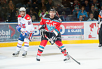 KELOWNA, CANADA - OCTOBER 10:  MacKenzie Johnston #22 of the Kelowna Rockets stops in front of Dylan Walchuk #21 of the Spokane Chiefs skates on the ice as the Spokane Chiefs visit the Kelowna Rockets on October 10, 2012 at Prospera Place in Kelowna, British Columbia, Canada (Photo by Marissa Baecker/Shoot the Breeze) *** Local Caption ***