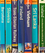Close up of various travel guide books published by Lonely Planet, Rough Guides, Brandt