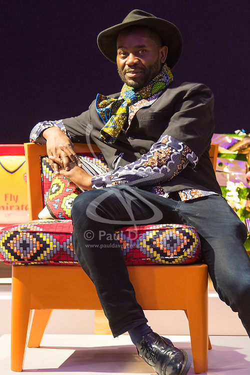 """Bonhams, London, February 29th 2016. Fashion designer and stylist Samson Soboye sits on the chair he created during a photocall for """"Sitting Pretty"""", featuring unique, hand painted and upholstered chairs made by 30 celebrities and artists, at Bonhams ahead of their auction in support of a leading AIDS charity, CHIVA Africa.<br /> ©Paul Davey<br /> FOR LICENCING CONTACT: Paul Davey +44 (0) 7966 016 296 paul@pauldaveycreative.co.uk"""