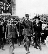 1944 Liberation of Paris.  To the left of de Gaulle is Georges Bidault (head of the Conseil National de la Résistance).  To the right is de Gaulle's personal delegate, Alexandre Parodi. The black man at the right of the picture is Georges Dukson, a 22-year-old who bravely fought in the Paris uprising.