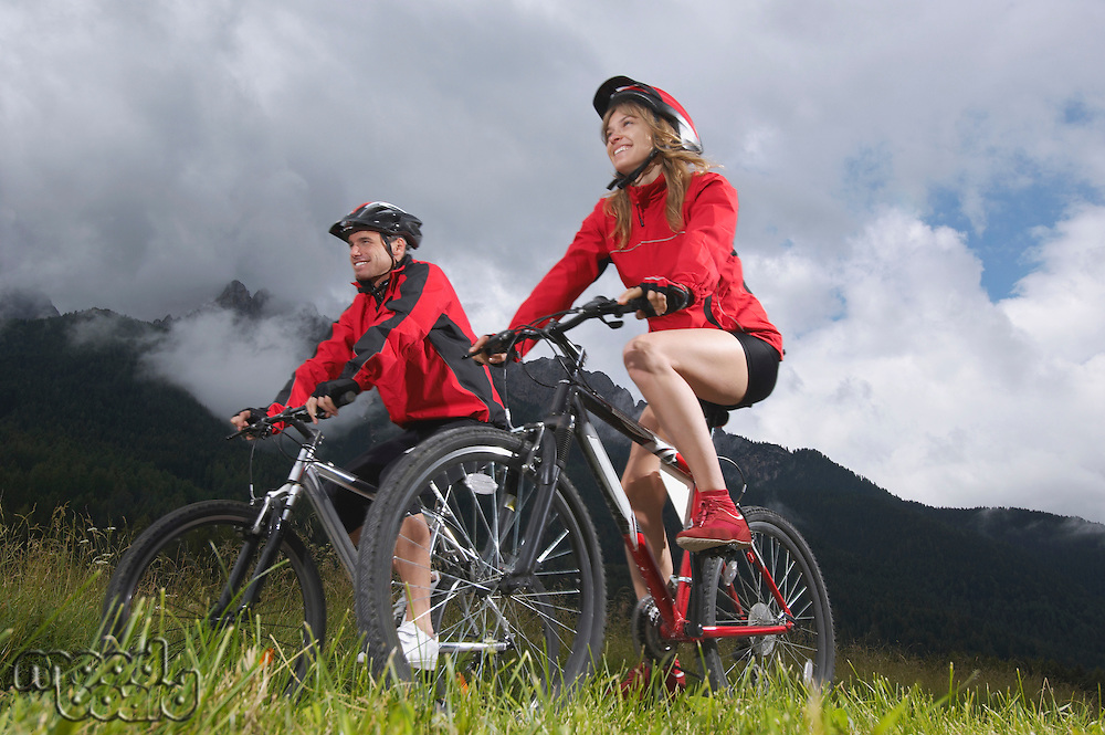 Couple cycling in countryside