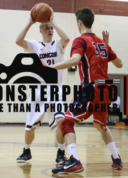 Concord Raiders Forward Joseph McHugh (31) looks for the open man as Plymouth Whitemarsh Forward Mike Lotito (35) defends in the first half of a regular season non-conference high school basketball game between the Plymouth Whitemarsh Colonials and Concord High Raiders Monday, Jan. 19, 2015 at Concord High School in Wilmington, DEL