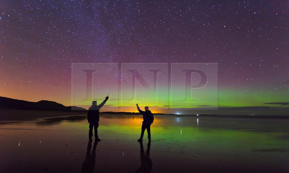 FILE PICTURE © Licensed to London News Pictures. 22/01/2012. London, UK. Aurora seen above people on the beach at Embleton Bay in Northumberland, UK, on the evening of 22 January 2012. The Aurora Borealis, known as The Northern Lights, which normally appear above Iceland and Norway, were seen further south this weekend due to unusual solar activity. Photo credit : Mike Ridley/LNP