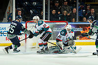 KELOWNA, CANADA - JANUARY 30:  Matt Barberis #22 tries to block a shot on Roman Basran #30 of the Kelowna Rockets as Henrik Rybinski #12 of the Seattle Thunderbirds scores the OT winning goal on January 30, 2019 at Prospera Place in Kelowna, British Columbia, Canada.  (Photo by Marissa Baecker/Shoot the Breeze)