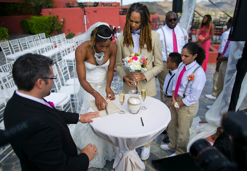 WNBA stars Glory Johnson, left and Brittney Griner sign their marriage license during their wedding at the Pointe Hilton Tapatio Cliffs Resort in Phoenix, Ariz. on May 8, 2015.