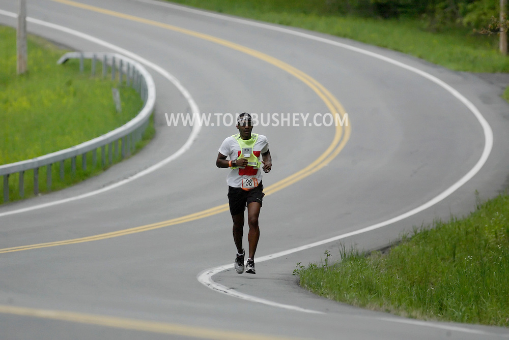 A runner heads up County Route 52 on the way to Walden during the Ragnar Relay on Friday, May 13, 2011.
