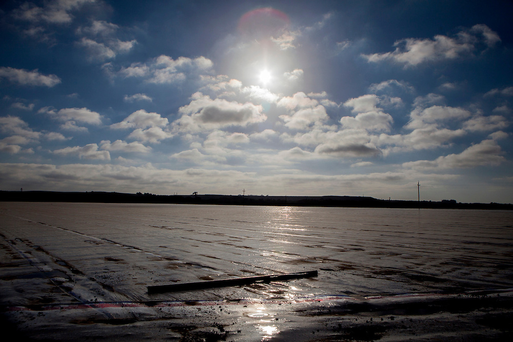 On a farm in Salinas, a protective sheet lies over the area where methyl bromide was recently applied in Salinas, California, U.S. on Sunday September 7, 2014.
