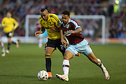 Andre Gray of Burnley and Emilio Nsue of Middlesbrough battle for the ball during the Sky Bet Championship match between Burnley and Middlesbrough at Turf Moor, Burnley, England on 19 April 2016. Photo by Simon Brady.