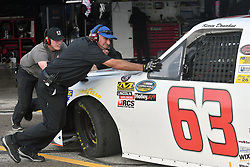 June 22, 2018 - Madison, Illinois, U.S. - MADISON, IL - JUNE 22: Members of Kyle Donahue's team (63) driving a Chevrolet for Mittler Brothers Machine and Tool push his truck out of the garage before  the Camping World Truck Series - Eaton 200 on June 22, 2018, at Gateway Motorsports Park, Madison, IL.   (Photo by Keith Gillett/Icon Sportswire) (Credit Image: © Keith Gillett/Icon SMI via ZUMA Press)