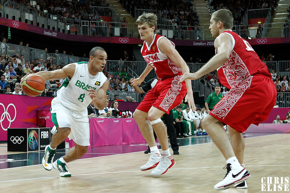 02 August 2012: Brazil Alex Garcia drives past Andrei Kirilenko and Sergey Monya during 75-74 Team Russia victory over Team Brazil, during the men's basketball preliminary, at the Basketball Arena, in London, Great Britain.