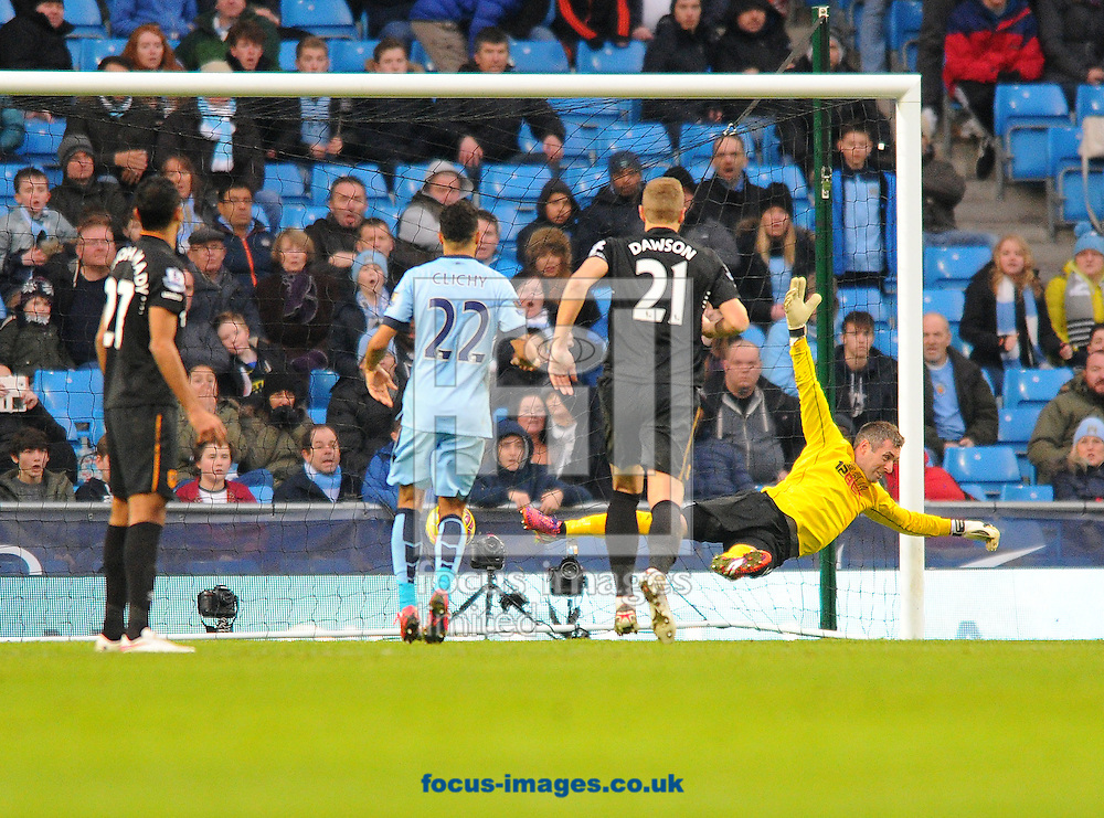 Hull City goalkeeper Allan McGregor (right) is beaten by James Milner of Manchester City (not pictured here) from a free-kick during the Barclays Premier League match at the Etihad Stadium, Manchester<br /> Picture by Greg Kwasnik/Focus Images Ltd +44 7902 021456<br /> 07/02/2015