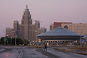 "Triumf Astana (Triumph of Astana) appartment building (l.), the Circus (""UFO"") at dawn."