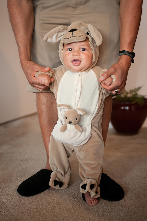 young child dressed in kangaroo costume taking first steps