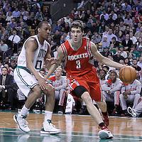 06 March 2012: Houston Rockets point guard Goran Dragic (3) drives past Boston Celtics shooting guard Avery Bradley (0) during the Boston Celtics 97-92 (OT) victory over the Houston Rockets at the TD Garden, Boston, Massachusetts, USA.