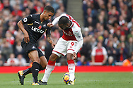 Kyle Naughton of Swansea City (L) nutmegs Alexandre Lacazette of Arsenal (R). Premier league match, Arsenal v Swansea city at the Emirates Stadium in London on Saturday 28th October 2017.<br /> pic by Steffan Bowen, Andrew Orchard sports photography.