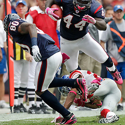 October 10, 2010; Houston, TX USA; Houston Texans fullback Vonta Leach (44) is upended by New York Giants cornerback Corey Webster (23) during the first half at Reliant Stadium. Mandatory Credit: Derick E. Hingle