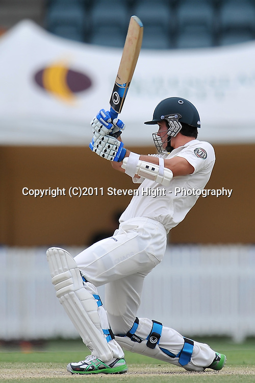 Ben Cutting follows through after nailing a boundary durng action from Day 3 of the Tour match between Australia A and New Zealand played at Allan Border Field from 24th - 27th November 2011~ Photo Credit Required : Steven Hight (AURA Images) ~ Editorial Use only in accordance with CA Terms & Conditions (2011-12)