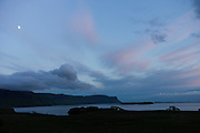 Panoramic sky scene view of pink and blue pastel colours and moon over Loch Na Keal at sunset on Isle of Mull, the Inner Hebrides and Western Isles in West Coast of Scotland
