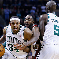 21 December 2012: Boston Celtics small forward Paul Pierce (34) drives past Milwaukee Bucks power forward Luc Richard Mbah a Moute (12) on a screen set by Boston Celtics power forward Kevin Garnett (5) during the Milwaukee Bucks 99-94 overtime victory over the Boston Celtics at the TD Garden, Boston, Massachusetts, USA.