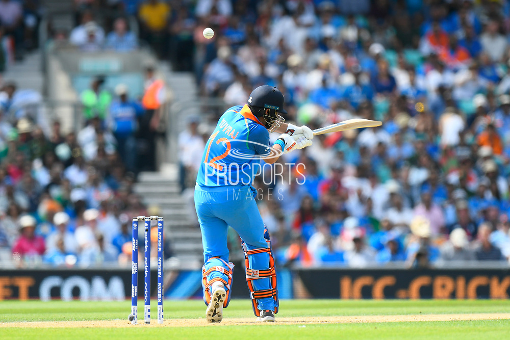 Yuvraj Singh of India hits the ball to the boundary for four runs during the ICC Champions Trophy final match between Pakistan and India at the Oval, London, United Kingdom on 18 June 2017. Photo by Graham Hunt.