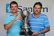 CAPE TOWN, SOUTH AFRICA, Monday 27 February 2011, Dylan Raubenheimer of Paul Roos Gimnasium, won the Proudfoot trophy during the Sanlam SA Amateur Championship held at the Mowbray Golf Club. With him is Gary van Loggerenberg of Sanlam..Photo by Roger Sedres/ImageSA