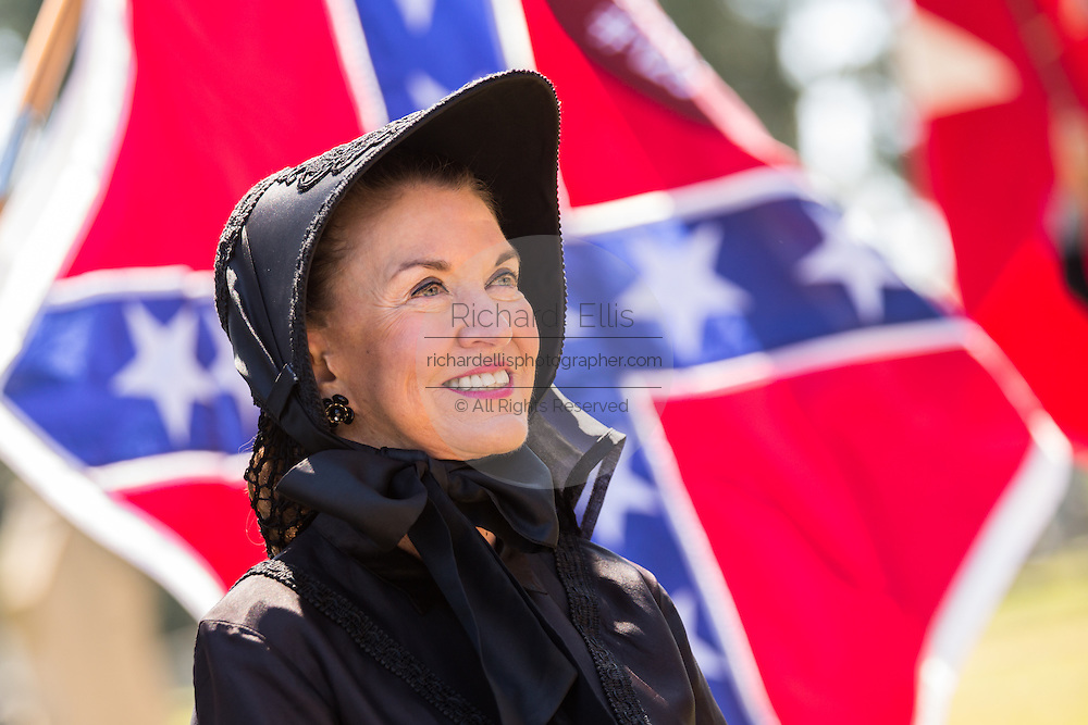 A women dressed in civil war mourning costume sings Dixie during a service at Elmwood Cemetery to mark Confederate Memorial Day May 2, 2015 in Columbia, SC. Confederate Memorial Day is a official state holiday in South Carolina and honors those that served during the Civil War.