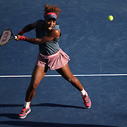 Serena Williams, USA, in action in the late afternoon light on Louis Armstrong Stadium during the Serena Williams and Venus WIlliams, USA, against  Anastasia Pavlyuchenkova, Russia and Lucie Safarova, Czech Republic, Women's Doubles, Round 3 match at the US Open. Flushing. New York, USA. 4th September 2013. Photo Tim Clayton