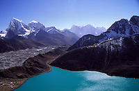 The view from the summit of Gokyo Ri looking down past the Ngozumpa Glacier and Mt Taboche.