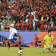 FOXBOROUGH, MASSACHUSETTS - JUNE 10: Arturo Vidal #8 of Chile is congratulated by Eduardo Vargas #11 of Chile after scoring the winning goal from the penalty spot in time added on beating a dejected goalkeeper Carlos Lampe #1 of Bolivia during the Chile Vs Bolivia Group D match of the Copa America Centenario USA 2016 Tournament at Gillette Stadium on June 10, 2016 in Foxborough, Massachusetts. (Photo by Tim Clayton/Corbis via Getty Images)