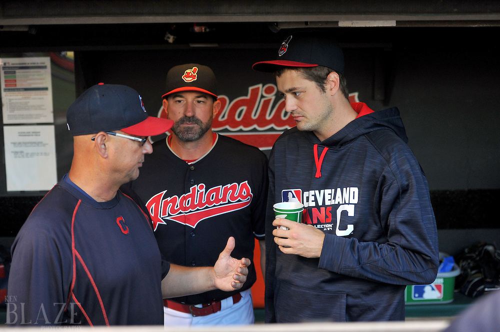 Aug 1, 2016; Cleveland, OH, USA; Cleveland Indians relief pitcher Andrew Miller (24) talks with manager Terry Francona (17) and pitching coach Mickey Callaway (32) before the game between the Cleveland Indians and the Minnesota Twins at Progressive Field. Mandatory Credit: Ken Blaze-USA TODAY Sports