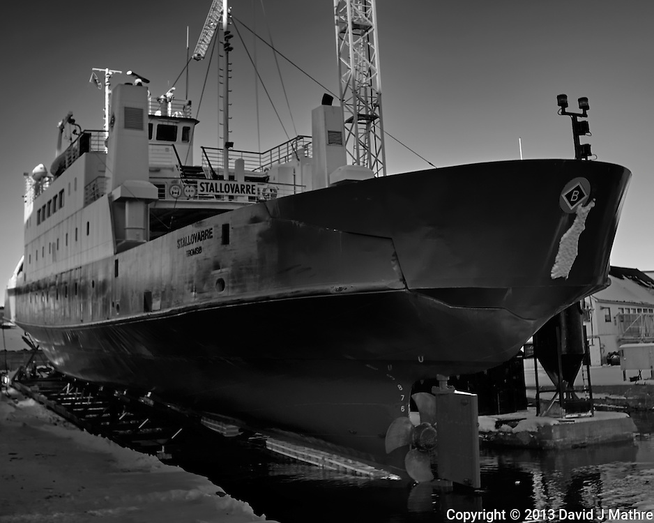 Stallovarre -- passenger/Ro-Ro cargo ship being winched into a dry dock in Tromsø, Norway. Image taken with a Leica X2 camera (ISO 100, 24 mm, f/5.6, 1/50 sec). Raw image processed with Capture One Pro (including conversion to B&W).