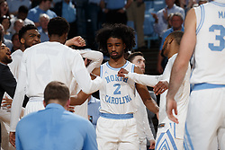 CHAPEL HILL, NC - FEBRUARY 05: Coby White #2 of the North Carolina Tar Heels enters during player introductions before a game against the North Carolina State Wolfpack on February 05, 2019 at the Dean Smith Center in Chapel Hill, North Carolina. North Carolina won 113-96. North Carolina wore retro uniforms to honor the 50th anniversary of the 1967-69 team. (Photo by Peyton Williams/UNC/Getty Images) *** Local Caption *** Coby White